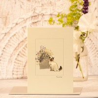 Siamese cat card next to large pot of flowers